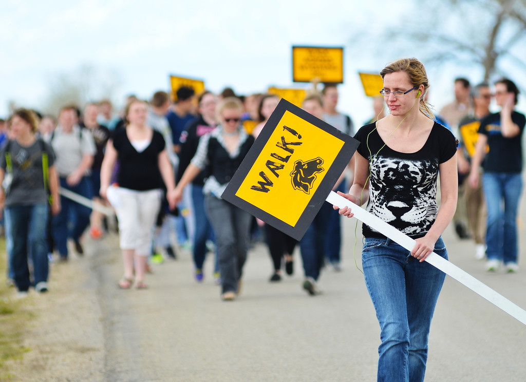 Jade Storm carries a sign in the Move Wyoming walk Wednesday at Sheridan High School. The students walked the perimeter of the high school grounds, which is approximately one mile. The walk was to encourage and promote physical activity in the community.