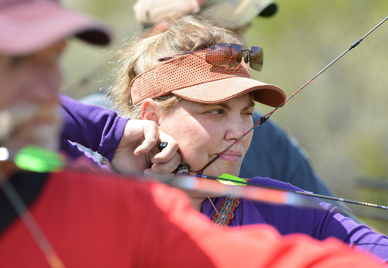 Shauna Morgan of Billings, Mont., aims for the target during the first annual WASCSA 3D Bow Shoot at Wildcat Archery East of Sheridan. The competition had more than 50 shooters from the region.
