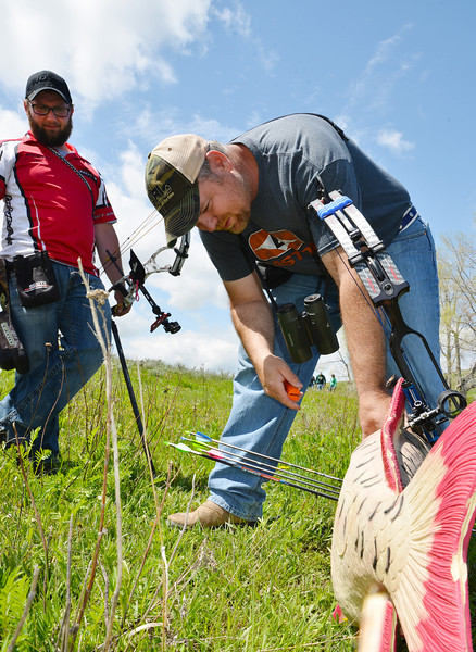 Dave Thompson of Sheridan, left, and Rob Morgan of Billings, Mont., inspect the target for scoring during the first annual WASCSA 3D Bow Shoot at Wildcat Archery East of Sheridan. The competition had more than 50 shooters from the region.
