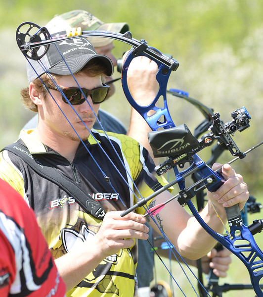 Tate Morgan of Billings, Mont., notches an arrow during the first annual WASCSA 3D Bow Shoot at Wildcat Archery East of Sheridan. The competition had more than 50 shooters from the region.