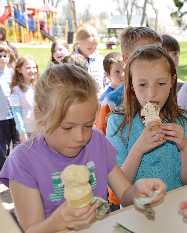 Meadowlark Elementary School third graders Abby Newton, left, and Sydni Bilyu buy ice cream from the ice cream stand in Kendrick Park Thursday during a field trip. The students took a tour of the Trail End Museum then visited Kendrick Park where the ice cream stand opened briefly for the students to get ice cream. A recent remodel of the building has placed the ordering window on the opposite side of the building for the safety of the customers from motor traffic. The Kendrick Park Ice Cream Stand officially opens for business this Saturday.