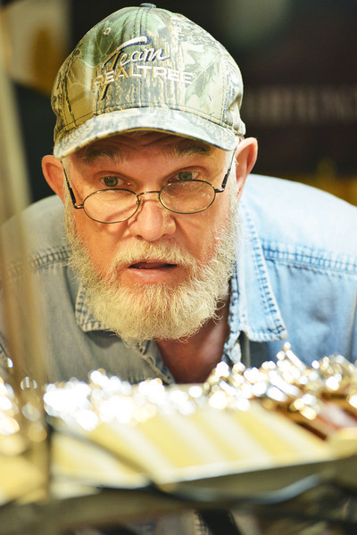 Wes Hibner of Walla Walla, Wash., looks takes a closer look at a display of leather stamping tools during the annual Leather Crafters Trade Show Friday at the Holliday Inn Convention Center.