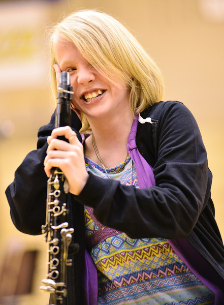 Hope Bowden smiles as the student assembly applauds her after she played the clarinet during the talent show Wednesday at Sheridan High School.