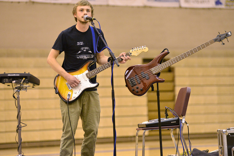 Ethan Chartier performs as a one-man band during the talent show Wednesday at Sheridan High School. Chartier took first place for the competition.
