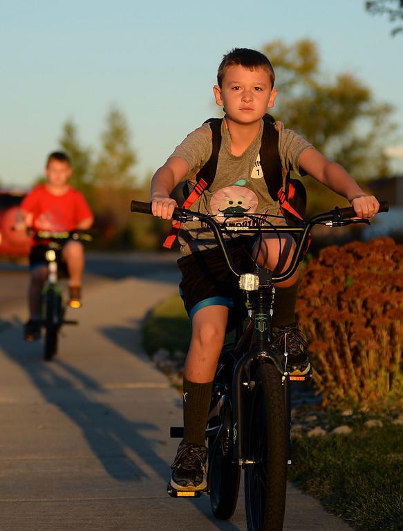 Third grader Tyler Hutton rides his bike to school Wednesday morning near Sagebrush Elementary School. Justin Sheely The Sheridan Press.