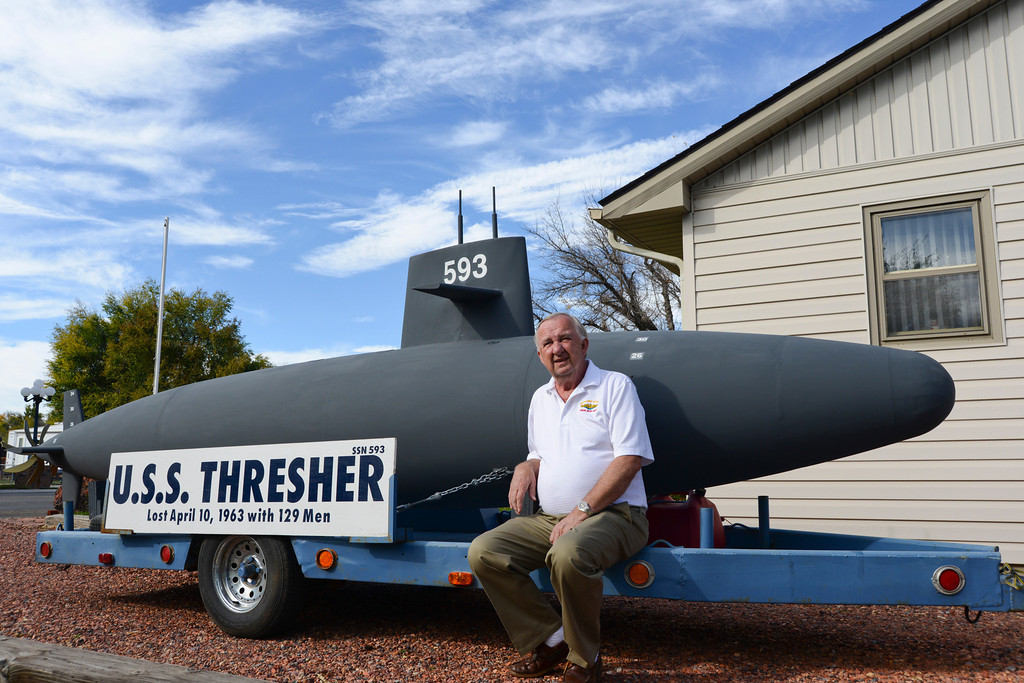 Ron Martini sits next to a 1/12 scale model of the U.S.S Thresher Wednesday afternoon at his home on DeSmet. Martini is part of the US Submarine Veterans, INC., which provided the model submarine to be displayed in Sheridan throughout next week. The sub will be displayed at the Sheridan College Thorne-Rider student center next Monday and Tuesday, and at the VAMC clinic entrance on Thursday and Friday, Oct. 16 and 17. Justin Sheely The Sheridan Press.