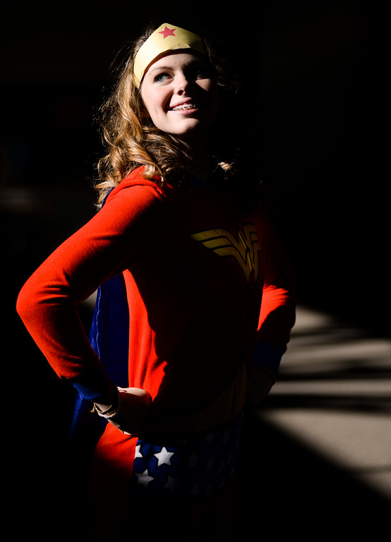 Sheridan junior and cheerleading team captain Hailey Longhurst dressed as Wonder Woman Tuesday for homecoming week at Sheridan High School. 'Super Heroes' was the theme for the dress up day. The high schoolers are dressing in costume according to various themes each day of homecoming week. Sheridan plays Cheyenne Central under the Friday night lights with a halftime fireworks show at Scott Field. Justin Sheely The Sheridan Press.