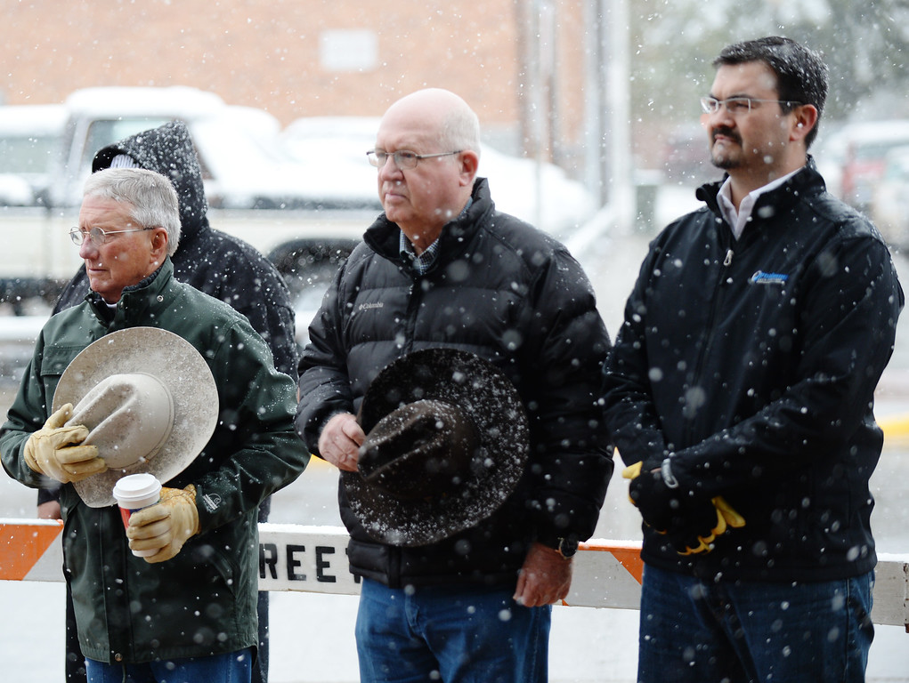 Sheridan County Commissioners Bob Rolston, left, and Tom Ringley stand with Sheridan City Councilman Jesus Rios for the observation of silence during the 9/11 remembrance ceremony Thursday morning at the Sheridan Fire-Rescue firehouse on Scott Street. The Sheridan Press Justin Sheely.