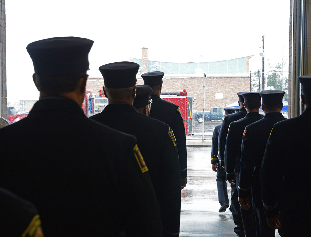 Sheridan Fire-Rescue officers and firemen march outside through the garage door during the 9/11 remembrance ceremony Thursday morning at the Sheridan Fire-Rescue firehouse on Scott Street. The Sheridan Press Justin Sheely.
