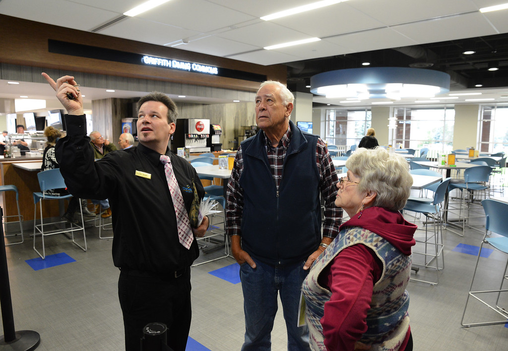 Floor manager Stuart Tamehill, left, points out the kitchen sign to guests Phil Zerwas and Jean Zerwas during the open house Wednesday in the Thorne-Rider Campus Center at Sheridan College. The Sheridan Press Justin Sheely.