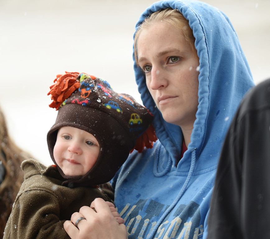 Amy Harnish holds her 19-month-old son Tucker Harnish as she watches the 9/11 remembrance ceremony Thursday morning at the Sheridan Fire-Rescue firehouse on Scott Street. The Sheridan Press Justin Sheely.
