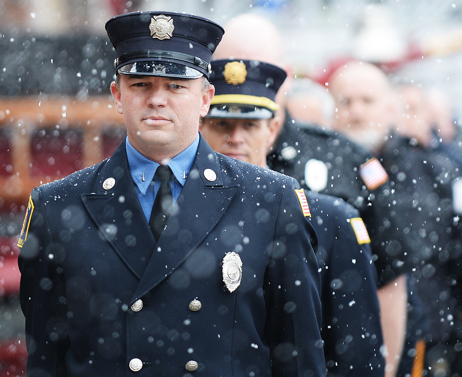 Sheridan Fire-Rescue Captain Robert Dobbs stands at attention as the bell rings to usher a moment of silence during the 9/11 remembrance ceremony Thursday morning at the Sheridan Fire-Rescue firehouse on Scott Street. The Sheridan Press Justin Sheely.