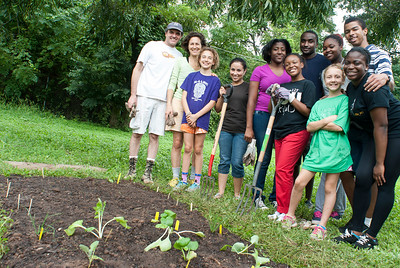A volunteer team including students from Houston Tillotson University after installing a new garden