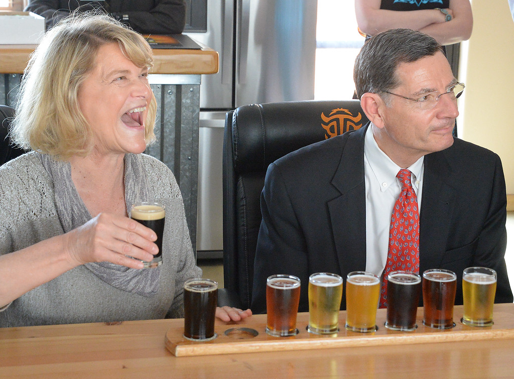 Rep. Cynthia Lummis, left, and Sen. John Barrasso are served a flight of beers during a tour Friday afternoon at Black Tooth Brewing Company. Governor Mead paid a visit to the local brewing company's expanded brewery during a visit to Sheridan with Sen. John Barrasso, Rep. Cynthia Lummis and Wyoming Treasurer Mark Gordon along with Sheridan County officials. The new brewing facility was expanded from 5,400 square feet to 13,000 square feet to allow the brewery to produce up to 50,000 barrels annually. The brewing company plans to distribute to the entire state of Wyoming and parts of Montana, North Dakota, South Dakota and Nebraska. Justin Sheely/The Sheridan Press.