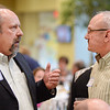 Sen. Bruce Burns, left, visits with Sheridan Mayor John Heath during the Whitney Benefits second annual Education Summit Tuesday evening at the Sheridan College Whitney atrium. Justin Sheely/The Sheridan Press