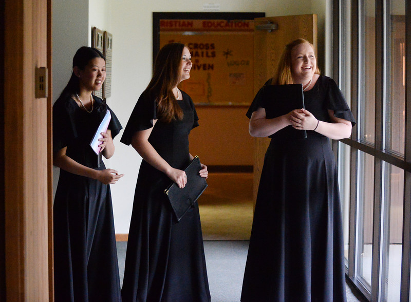 "Sheridan College Chamber Choir members Shannon Mullin, left, Hannah Varney and Heather Vrieswyk wait out in the hallway as the Collegiate Chorale performs during the Sheridan College Music Department's ""A Mostly Mozart Concert"" Saturday evening at First Presbyterian Church. Justin Sheely/The Sheridan Press."