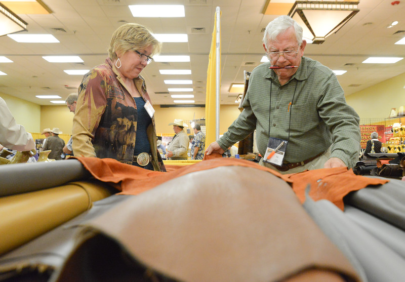 Julie Pierce, left, of Lewiston, Idaho, purchases leather from vendor Cal Zuege during the Rocky Mountain Leather Trade Show Friday at the Holiday Inn Convention Center. Pierce is a leather seamstress whose work includes making chaps for rodeo royalty. The leather crafters convention has been meeting in Sheridan for 22-years. The event has brought teachers and leather workers from across the globe. Justin Sheely/The Sheridan Press.