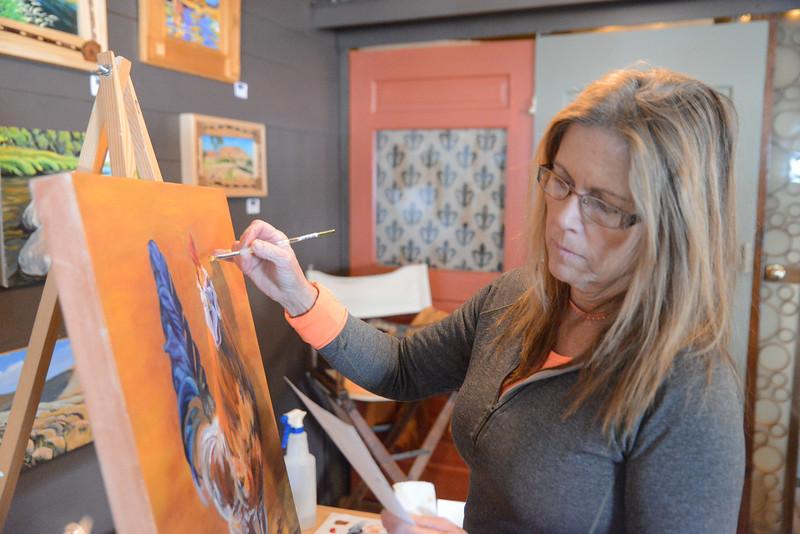 Lisa Boyd of Parkman paints an acrylic chicken during the Dayton Art Loop Studio Tour Saturday in Dayton. Justin Sheely / The Sheridan Press.