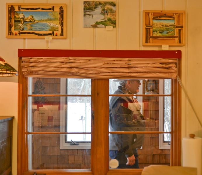 Wayne Fahsholtz walks into the entryway of David McDougall's home studio during the Dayton Art Loop Studio Tour Saturday in Dayton. Justin Sheely / The Sheridan Press.