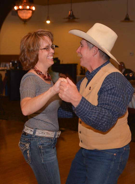 Jodi Ilgen and Jodi Ilgen dance during the Sheridan WYO Rodeo Royalty annual fundraiser dinner Saturday at the Historic Sheridan Inn. Justin Sheely / The Sheridan Press.