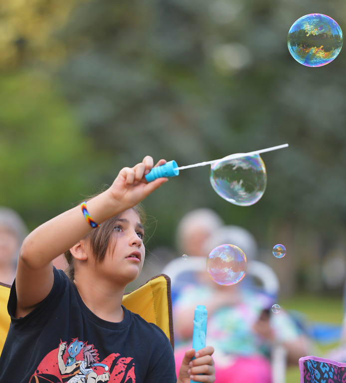Justin Sheely | The Sheridan Press<br /> Ten-year-old Cleo Victor, visiting from France, makesh bubbles during Concerts in the Park Tuesday evening at Kendrick Park. Concerts in the Park are held every Tuesday at 7:30 through Aug. 16.