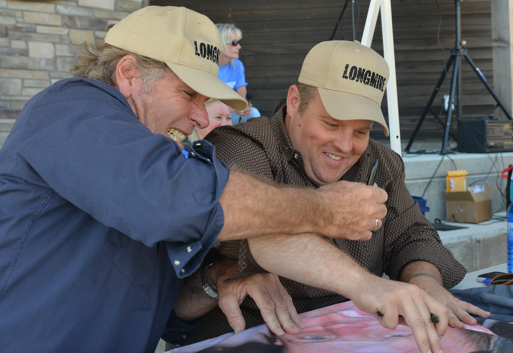 Justin Sheely | The Sheridan Press<br /> Robert Taylor – Sheriff Longmire, left, jokes around with Adam Bartley – The Ferg – for an autograph session during Longmire Days Friday in Buffalo. 2016 marks the 5th year of Longmire Days for the town of Buffalo, which hosted several events involving the cast and members of the crew to meet their fans. Longmire started out on cable television in 2012 and is now a series on Netflix. The show follows the exploits of Sheriff Walt Longmire in fictional Absaroka County, Wyoming. The series is from local author Craig Johnson's books, who based the fictional town in his books on Buffalo, Wyoming.