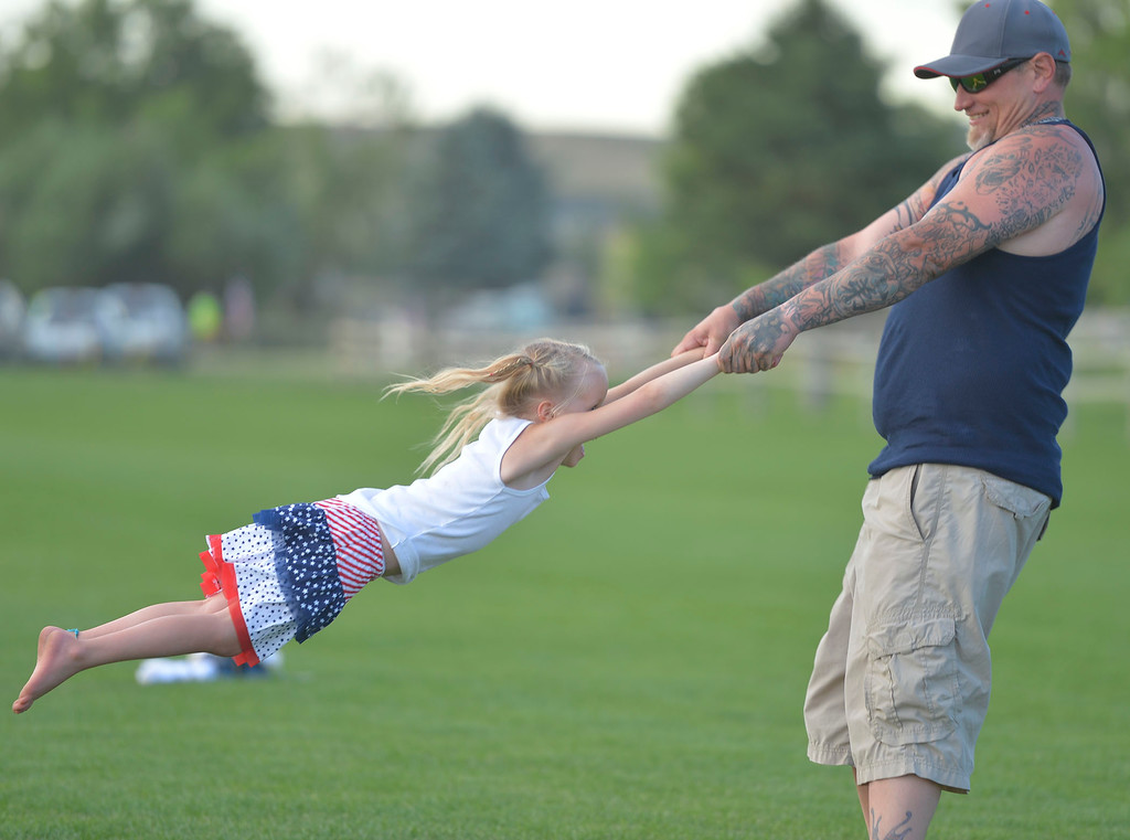 Mike Dunn | The Sheridan Press. <br /> Eric Blushill, right, spins around Addy Mackay during the Fourth of July celebrations at the Big Horn Equestrian Center.