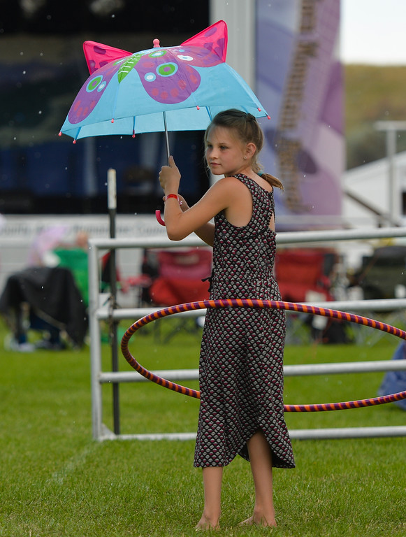 Justin Sheely | The Sheridan Press<br /> Eight-year-old Kylee Hart entertains herself during the Bighorn Mountain Music Festival Saturday morning at the Johnson County Fairgrounds in Buffalo.