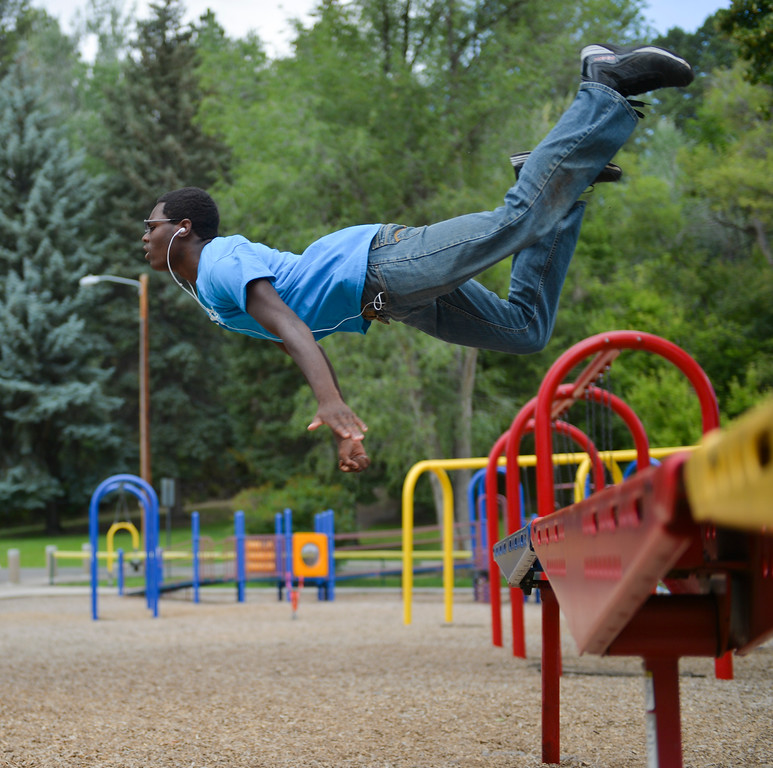 Justin Sheely | The Sheridan Press<br /> Sheridan high schooler Kenneth Grant leaps over playground equipment to practice a flying break-fall –a controlled landing – Tuesday afternoon at Kendrick Park. Grant says that he has a second degree blackbelt in taekwondo and a first degree black belt in judo. He likes to practice the running jumps and controlled landing when he sees an opportunity to do it safely.