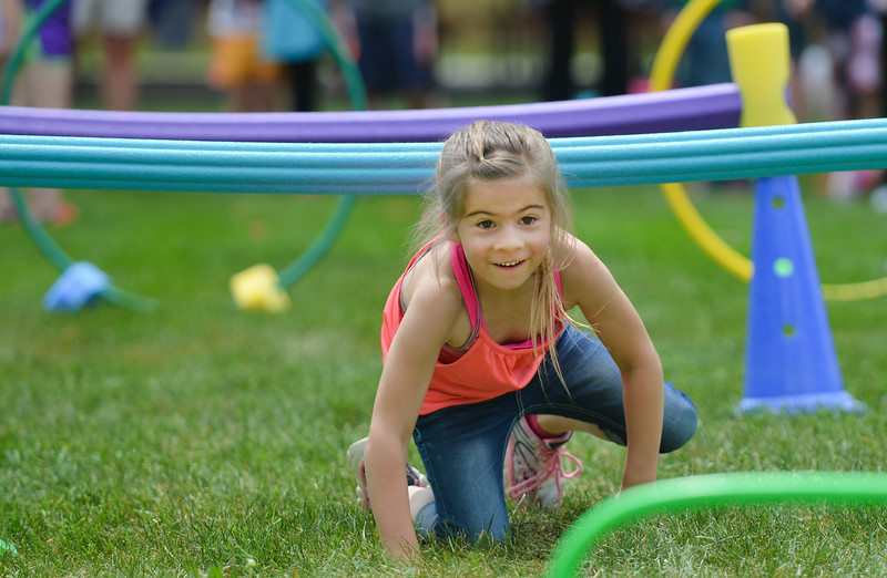 Justin Sheely | The Sheridan Press<br /> Kindergartener Cloe Troll runs through an obstacle course during the field day event on the last day of school for Sheridan County School District 3 at Arvada-Clearmont Schools Tuesday in Clearmont.