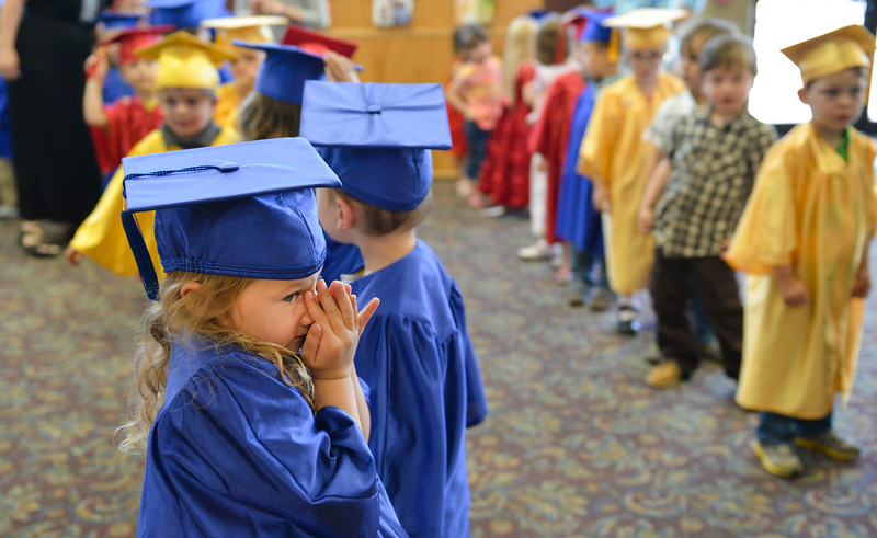 Justin Sheely | The Sheridan Press<br /> Laila Crivello waits with her peers in the lobby during The Children's Center Preschool twelfth-annual graduation last May at Sheridan Wesleyan Church. The Children's Center Preschool has been operating in Sheridan for 42 years.