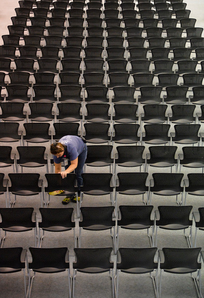 Justin Sheely | The Sheridan Press<br /> A college employee wipes down a row of more than 400 chairs in preparation for the graduation commencement Thursday at the Sheridan College Golden Dome. Commencement takes place this Saturday at the Golden Dome.