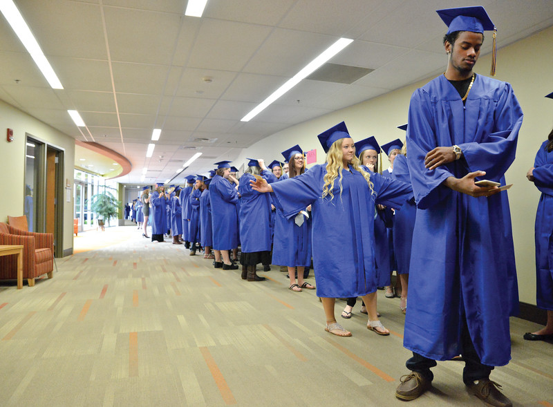 Mike Dunn | The Sheridan Press. <br /> Sheridan College students wait in line prior to the commencement ceremony at the Whitney Academic Center.