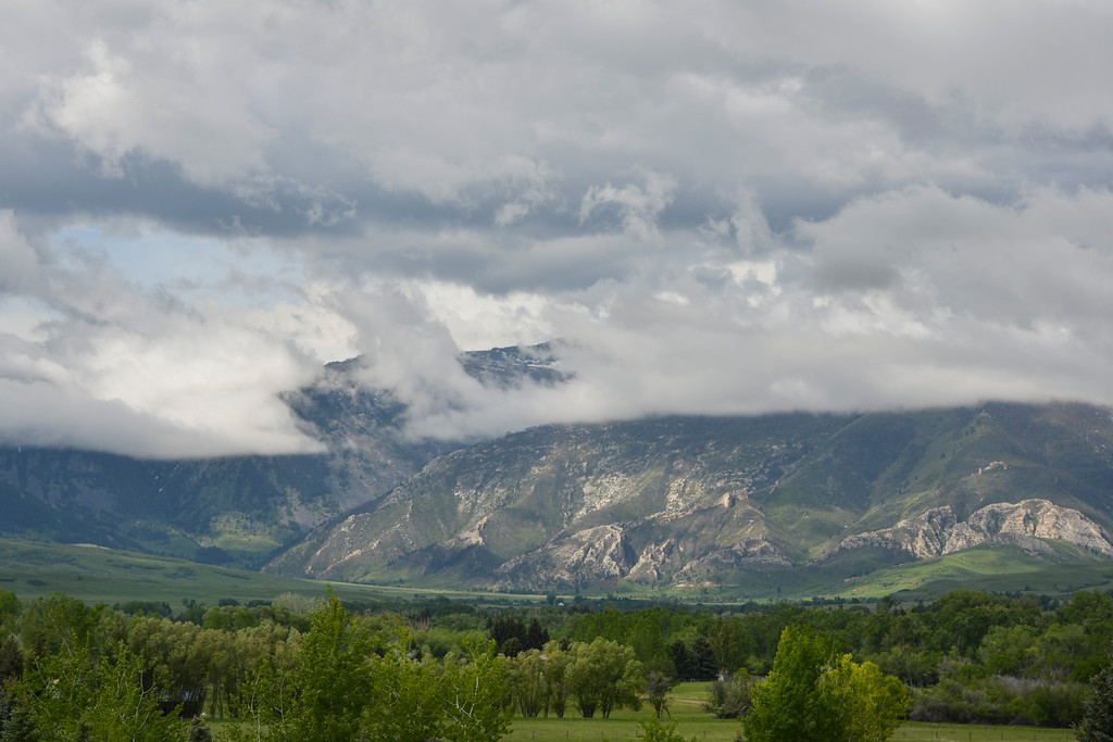 Justin Sheely | The Sheridan Press<br /> Clouds move over the Bighorn Mountains near the Little Goose canyon Thursday at Big Horn. The valley had isolated showers throughout the day.