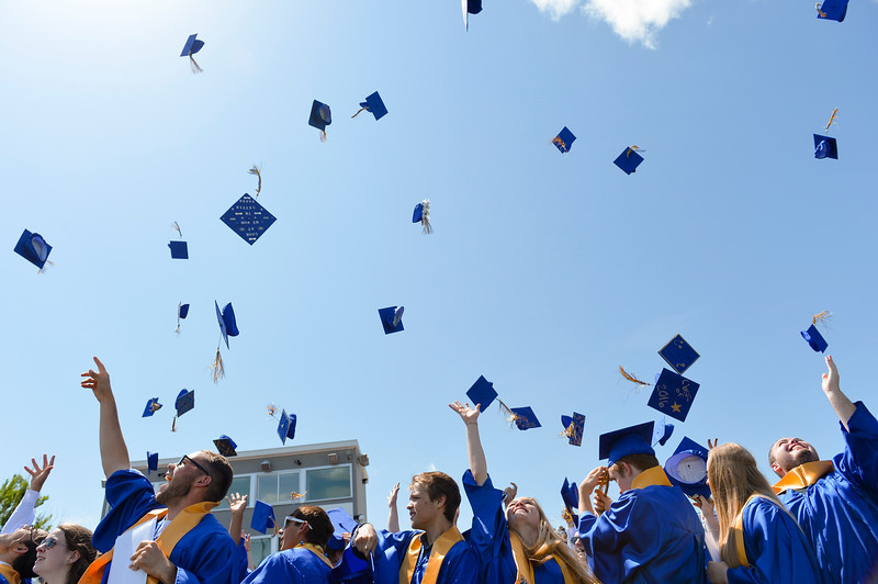 Justin Sheely | The Sheridan Press<br /> Graduates toss their hats at the conclusion of the 2016 commencement ceremony Sunday afternoon at Sheridan High School.