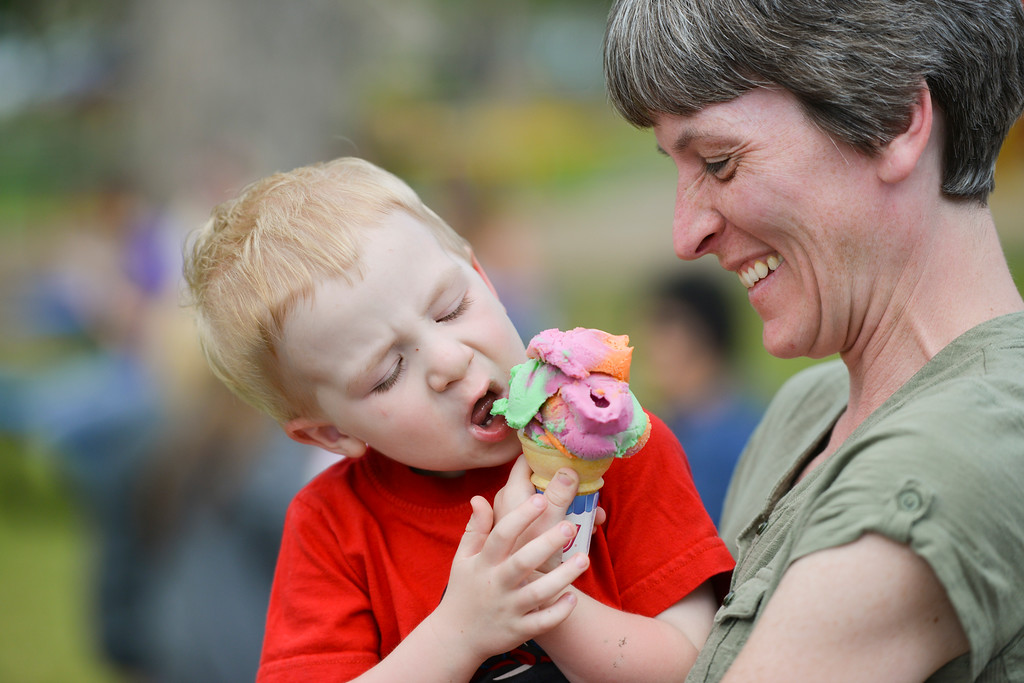 Justin Sheely | The Sheridan Press<br /> Jen Tranas holds three-year-old Nick Fackrell on Kendrick Ice Cream's opening weekend Saturday at Kendrick Park. Summer hours for the ice cream stand begin Saturday, June 4 from 10:30 a.m. to 9 p.m.