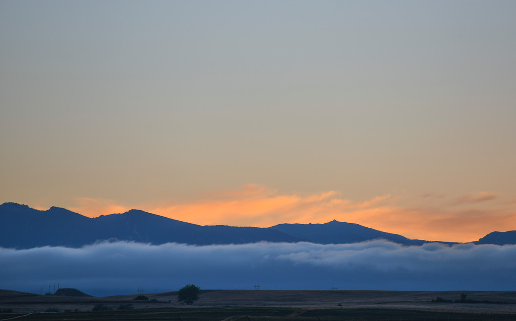 Justin Sheely | The Sheridan Press<br /> A patch of fog is seen in front of the Bighorn Mountains Tuesday night from the Sheridan County Airport. This week is to remain cool and rainy until Friday.