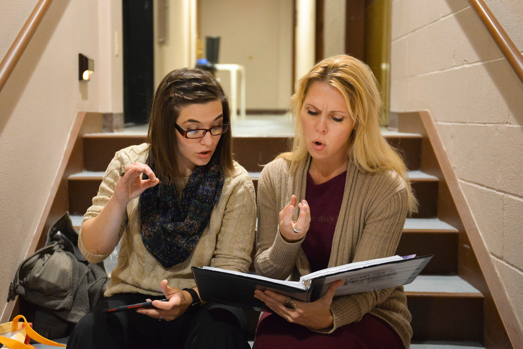 "Justin Sheely | The Sheridan Press<br /> Actors Stephanie Zukawski, left, and Erin Krantz practice notes from a musical score during a rehearsal for the upcoming gala performance ""Lend Me a Tenor"" Thursday night at the WYO Theater."