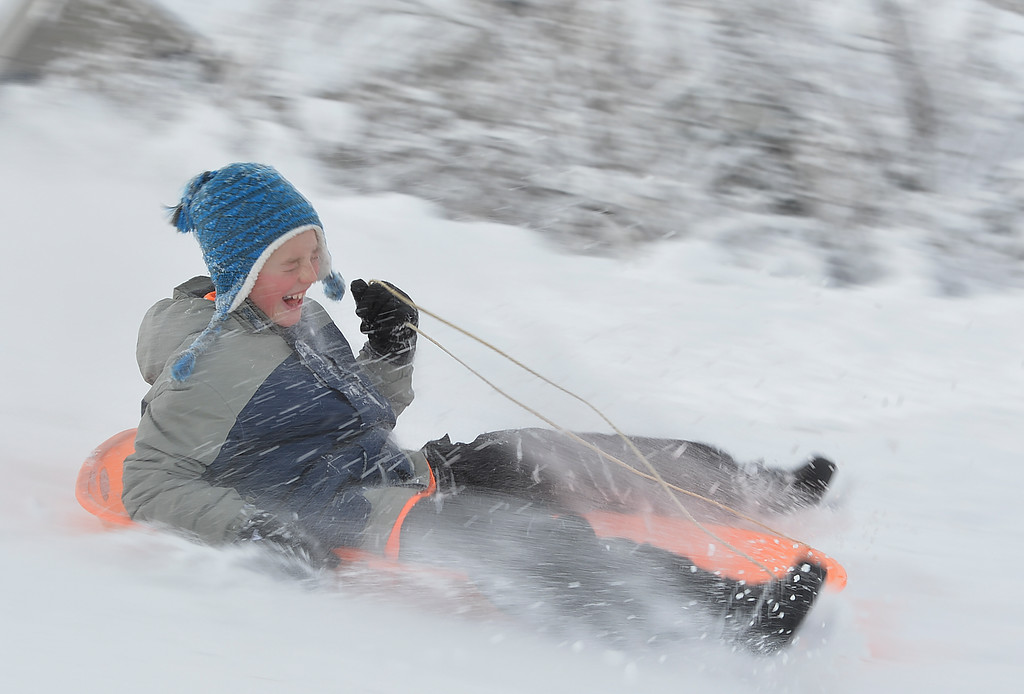 Justin Sheely | The Sheridan Press<br /> Snow blasts Ten-year-old Bridger Mortensen's face as he flies down the slopes on Linden Hill Saturday in Sheridan.