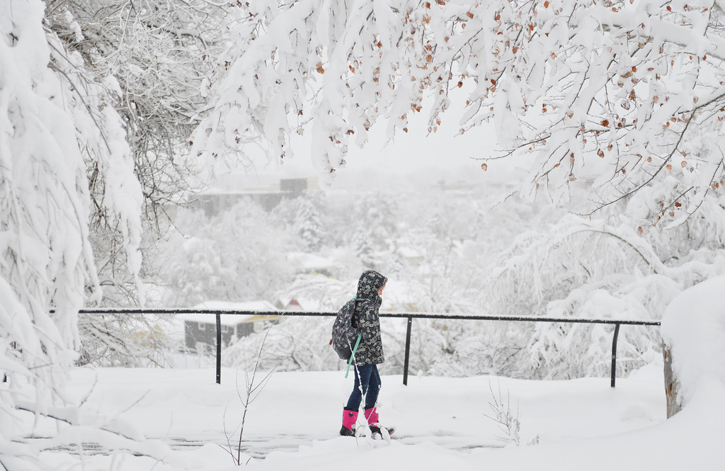 Justin Sheely | The Sheridan Press<br /> A student walks down the hill after class at Sheridan Junior High School Thursday afternoon in Sheridan. By noon Thursday, Sheridan received 9 inches of accumulation.