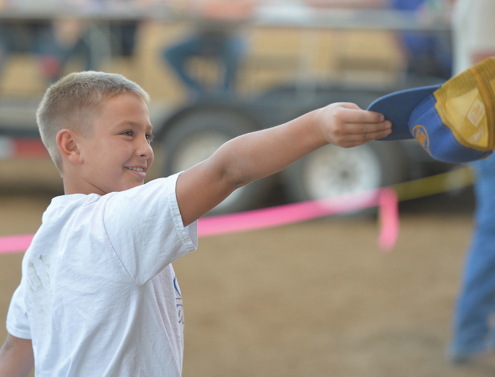 Mike Dunn | The Sheridan Press.<br /> Kelten Crow tries to earn more money for his team during the Calcutta auction.Several spectators attended the Sheridan County Fair Pig Wrestling event Saturday at the Sheridan County Fairgrounds Arena.