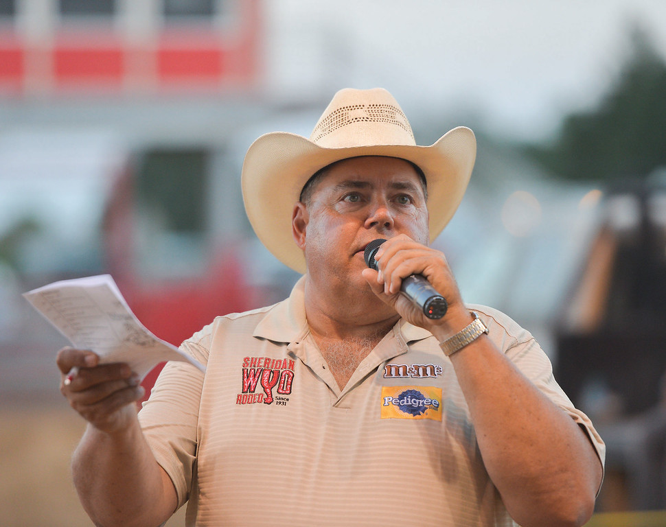 Mike Dunn | The Sheridan Press.<br /> Nick Siddle takes bids from the audience during the Calcutta auction.Several spectators attended the Sheridan County Fair Pig Wrestling event Saturday at the Sheridan County Fairgrounds Arena.