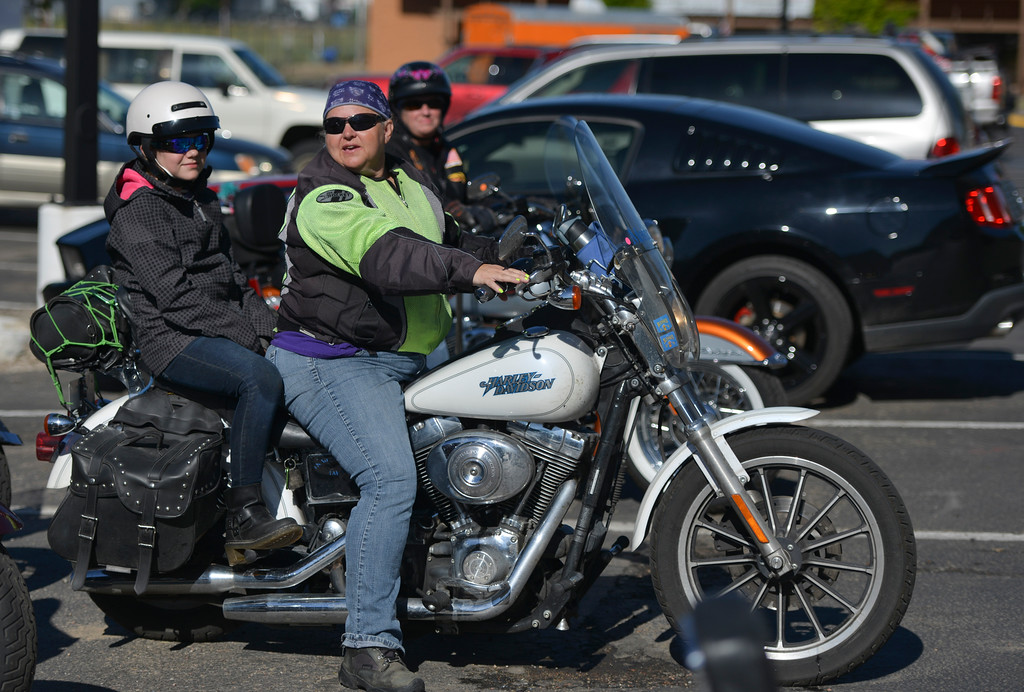 Justin Sheely | The Sheridan Press<br /> Eleven-year-old Kylie Carter sits behind Candi Long before hitting the road for 'Sweeties on Wheelies' charity run Saturday at the Holiday Inn parking lot. The women-only ride is an annual event since 2002 to support a charity – this year is Child Advocacy of the Bighorns. The route took the women to Ucross, Buffalo, Lake DeSmet, Story and back to Sheridan.