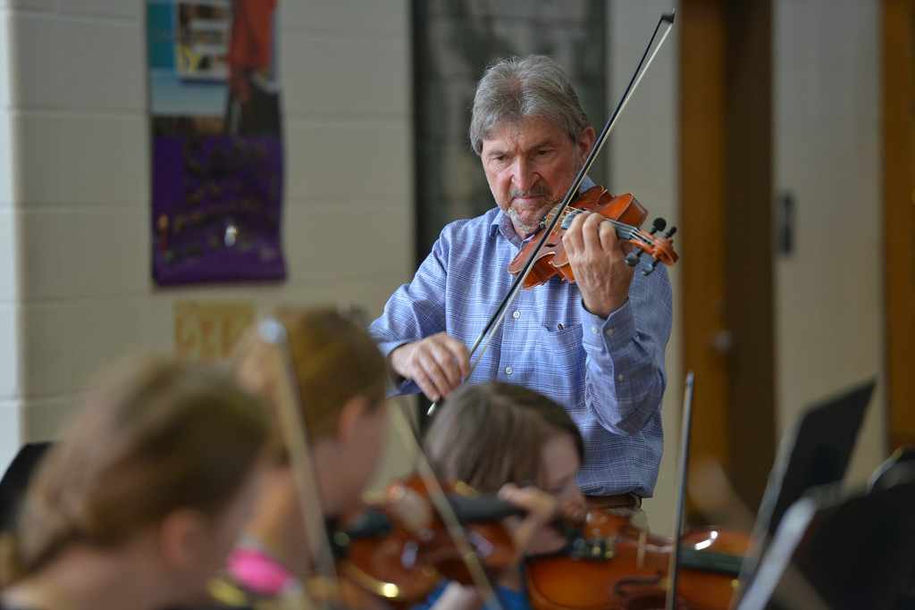 Justin Sheely | The Sheridan Press<br /> Razmick Sarkissian, SHS director of orchestras, leads a group of students during the Summer Strings program Thursday at Sheridan High School. The week long program ends Friday at noon with a concert for the youth's family and the general public at the Sue Henry auditorium.