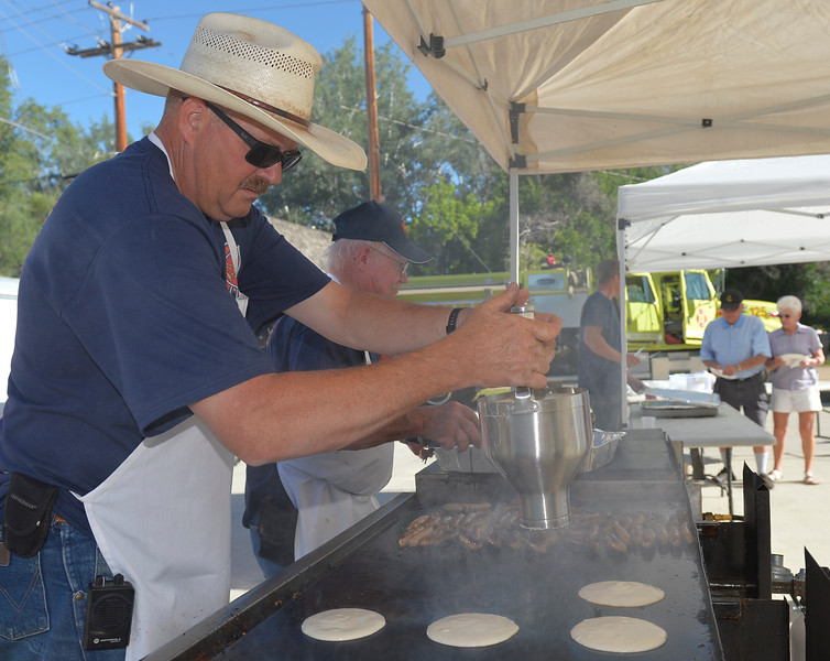 Justin Sheely | The Sheridan Press<br /> Lonnie Wright cooks pancakes during the annual pancake breakfast Saturday at the Big Horn fire station. The volunteer fire department served breakfast for the community and held tours of the fire engines.
