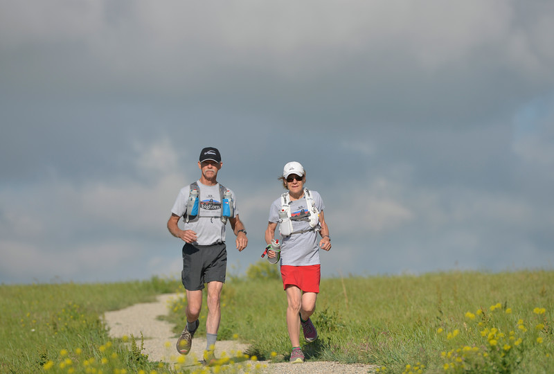 Justin Sheely | The Sheridan Press<br /> Paul and Mary McDoell, of Ranchester, jog down soldier ridge trail in Sheridan. Mary will be going on her first 100-mile run during the Big Horn Mountain trail run this weekend at age 61 with her husband, Paul McDoell, 64, who is running his second 100-mile trail run.