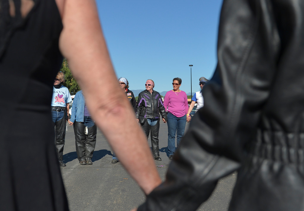 Justin Sheely | The Sheridan Press<br /> Women bikers hold hands in a circle to say a prayer before hitting the road for 'Sweeties on Wheelies' charity run Saturday at the Holiday Inn parking lot. The women-only ride is an annual event since 2002 to support a charity – this year is Child Advocacy of the Bighorns. The route took the women to Ucross, Buffalo, Lake DeSmet, Story and back to Sheridan.
