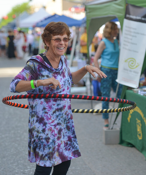 Justin Sheely | The Sheridan Press<br /> Tracy Morrin of Riverton, Wyoming, plays with a hulahoop during the first Third Thursday street festival this summer on Main Street.