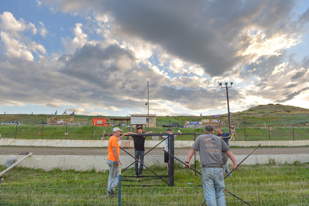 Justin Sheely | The Sheridan Press<br /> Volunteers remove a platform during a clean up day by the Sheridan Motorsports Association Thursday evening at Sheridan Speedway. Dozens of volunteers came to clean up trash, cut weeds and make improvements to the dirt track and facilities after the speedway closed earlier this month. The association plans to open up the track for its first event of the year on Sunday, June 26 at 5 p.m. Tickets are $12 for adults, $8 for seniors and students. Free admission for children under 12.