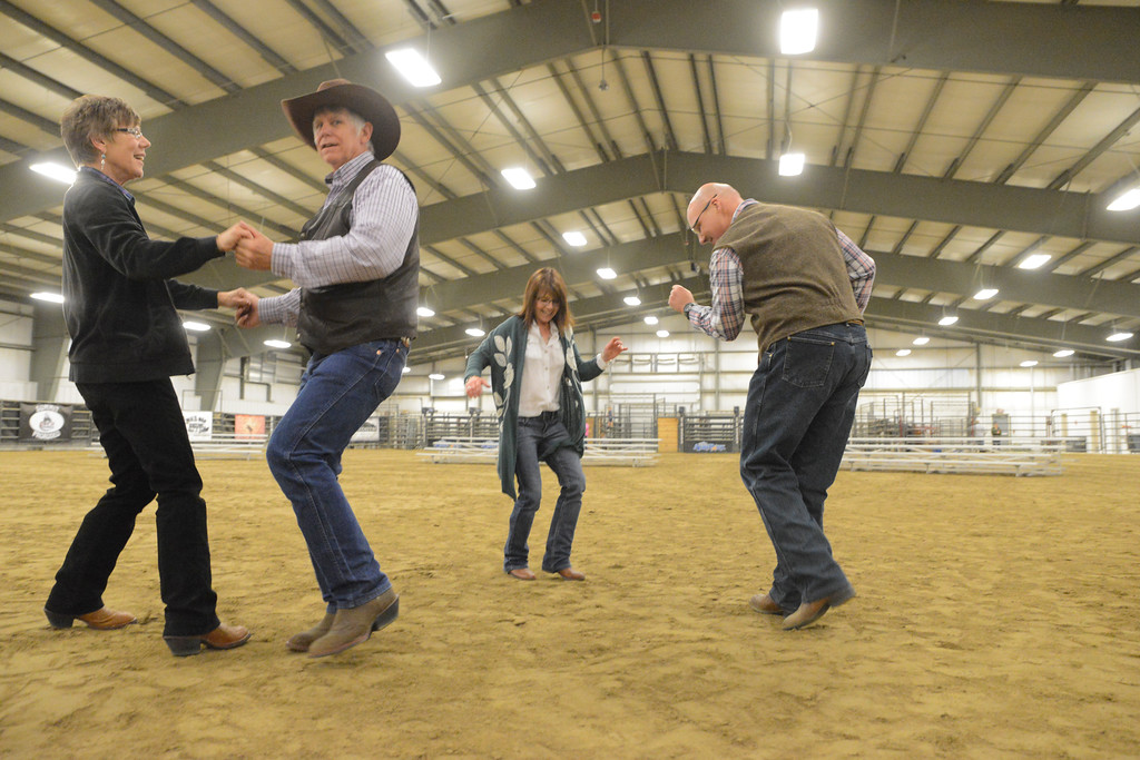 Justin Sheely | The Sheridan Press<br /> From left, Marje Graham, Craig Smith, Anita Weber and Mark Torbert dance as The Craft Brothers play during the CHAPS fundraiser dinner Saturday at the Sheridan College AgriPark arena. CHAPS (Children, Horses and Adults in PartnerShip) is a nonprofit equine assisted therapy program for individuals with special needs.